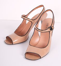 Classic peep toe sling back Mary Jane in nude and black by Prada