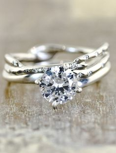 Love how the bands are branch-like, but delicate and how the diamond really shines.