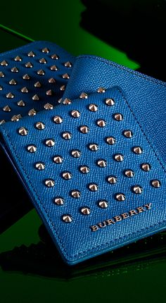 Studded wallets in vibrant blues from the Burberry A/W13 men's accessories collection