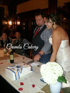 Edmonton oilers wedding cake. Bride and groom cutting cake. #crumbscakery