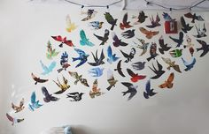 Bird wall. Crafter printed stencils she found online and then traced them onto magazine pages, cut out and attached to wall. Very creative.