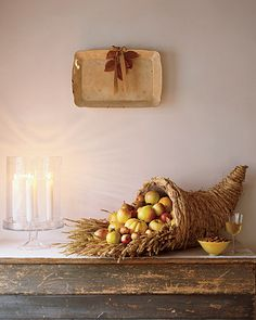 Cornucopia - A raffia cornucopia lined with a bed of dried wheat stalks creates a striking effect while holding an abundance of golden squashes, apples, and pears.