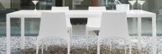 Seram by Pagnon & Pelhaitre. Base and crosspieces in gloss black or white lacquered anodised aluminum. Inset top in 1/4'' thick black or white lacquered toughened glass. May be used either indoors or outdoors. www.lignerosetsf.com #LiveBeautifully