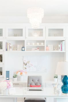 This little spot is where preppy accents and peonies mingle; where storage is bountiful, the bar cart is stocked to the gills and fab reading material is at the