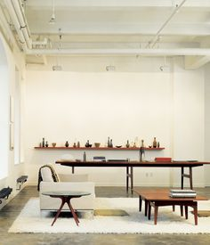 The oversize conference table in Bob Weinstein's live/work loft (like the cocktail table in the foreground) was designed by Jens Risom, a...