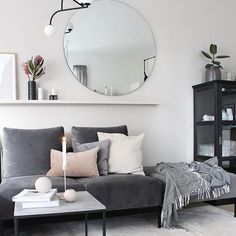 Plush velvets, a round mirror, blush accents and protea blooms to boot. Does it get any more perfect? #stylishinteriors