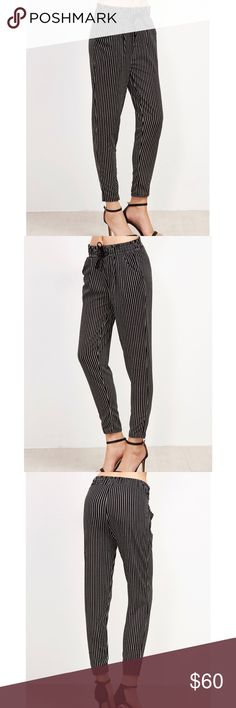 Brand New Vertical Pinstriped Drawstring Pants Super cute never worn brand new vertical pinstriped drawstring pants. Could be worn casually and professionally. One size, but will fit better for S/M. I'm normally a 5-7 in pants and this is a little tight on the calves for me. My loss is your gain. Bought for $49 on sale, original price $69. TAGGED BRAND FOR EXPOSURE ONLY! Quality made, no brand, only sold in boutiques! Brandy Melville Pants Trousers