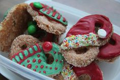 Krakeling Santa and Elf Hats. A sweet buttery pretzel-shaped cookie covered with white chocolate, candy melts, and sprinkles.