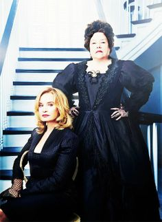 Jessica Lange (seated) as 'Fiona Goode', and  Kathy Bates as 'Madame Delphine LaLaurie'.