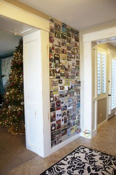 Christmas card wall...until I bind them with rings for this years book