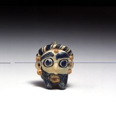 Phoenician or Carthaginian Glass Pendant in the Form of a Banded Head of a Bearded Man | Flickr: Intercambio de fotos
