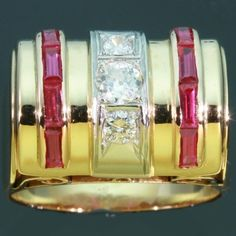 Retro ring, circa 1940s, three stones diamond .34 ct, rubies channel setting, 18kt yellow gold shank, curly gallery, excellent condition.