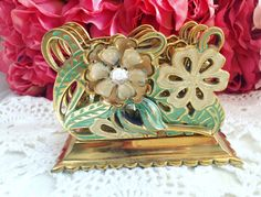 A personal favorite from my Etsy shop https://www.etsy.com/listing/400876747/antique-gold-napkin-holder-vintage