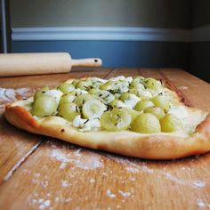 Grape, Rosemary, and Chevre Pizza. This sounds like a fun appetizer.