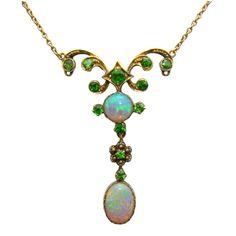 A 14 Karat Yellow Gold, Opal & Tsavorite Green Garnet Necklace - circa 1880. Love the colors!