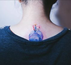 'The Little Prince' inspired tattoo on the upper back.