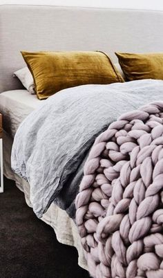 Mauve thick knit throw and mustard velvet sham