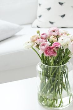 #flowers- love the pink colors for flowers with white couch in background