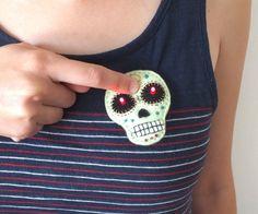 http://www.instructables.com/id/E-textile-felt-skull-brooch/