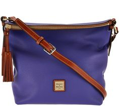 Keep your everyday essentials close at hand--while giving your everyday outfit a cute little flourish--with this Dooney & Bourke small crossbody bag. Page 1 QVC.com