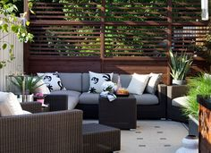 A Toronto rooftop get a luxurious makeover--privacy screens, lighting, an outdoor kitchen and safety measures for pets make this spacious rooftop patio comfy for all (Terra Firma Design)