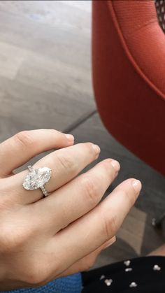 Vintage Edwardian engagement ring set with a 5.05 carat moval / marquise cut diamond.