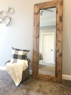 A plain, basic, full-length mirror that's doing nothing for your home decor game. It's time to step it up buttercup, and give this mirror a makeover. In this DIY post, I'll show you how to build a rustic wooden mirror frame. Wood Framed Mirror, Rustic Mirrors, Diy Mirror, Mirror Ideas, Pallet Mirror Frame, Decorative Mirrors, Vintage Mirrors, Reclaimed Wood Mirror, Sunburst Mirror