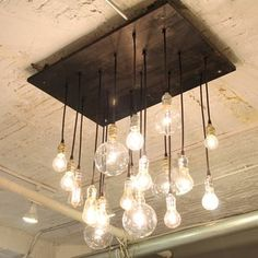 Love this vintage light bulb chandelier