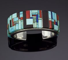 Cuff | Charles Loloma.  Sterling silver inlayed with turquoise, ironwood, Mediterranean coral, and lapis.  ca. 1970s