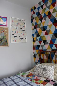 DIY wallpaper- really painted triangles with a cutout cardboard stencil.