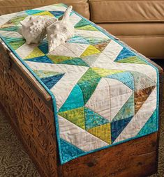 Table runner quilt patterns are fun to make between those larger bed-size quilt projects. Especially, when they use beautiful batik fabrics like this one called Island Chain by Pam Biswas! With fabrics like this, you'll want to get the quilt kit while supplies last.