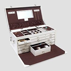 """""""What do you get the woman who has everything? Storage! This leather-covered jewelry holder with 12 drawers, smart locks, and a lift-out takeaway box for travel is worthy of holding the crown jewels.""""--Oprah"""