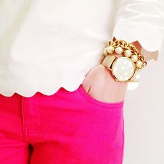 Pink jeans/ Scalloped white shirt/ Gold accessories/