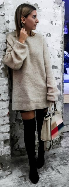 Aylin Koenig + utterly cosy + gorgeous knitted sweater + oversized + pair of thigh high boots + simple yet effective winter style + seasonal classic!  Brands not specified.