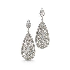 Large filigree hanging earrings from the Kwiat Vintage Collection in 18K white gold  Three dimensional and beautiful from every angle, these filigree diamond earrings from Kwiat Vintage are a bold statement.