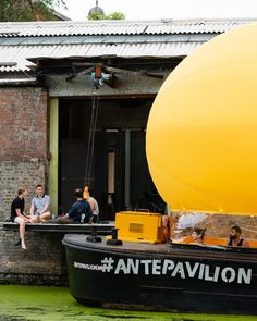 Architects Thomas Randall-Page and Benedetta Rogers have created an inflatable arts venue on a barge that unfurls in just 12 minutes, for Antepavilion Architecture Foundation, London Architecture, Dezeen, East London, Pavilion, Pop Up, Theatre, Urban, Yellow