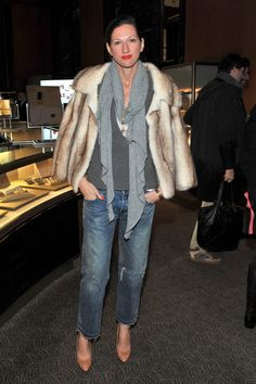 love the juxtaposition of the fur and ripped jeans