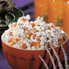 Ingredients  1 bag of Popped Popcorn White Chocolate Almond Bark Halloween M&M's® or Reese's Pieces®