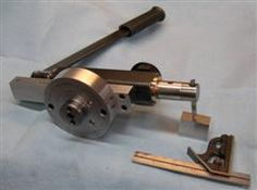 It is a slotter that mounts on the cross slide in place of the compound on my South Bend 9. It can make gears, dial markings, cog belt pulleys, splines and of course keyways, internal and external. Different size tool holders can be fitted to the business end to work in small openings or large.