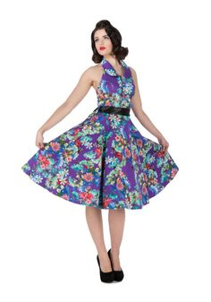 This beautiful floral cotton dress is in vibrant shades of violet, blues, greens, and reds. Dress is sleeveless and backless and hooks around the neck with a collar and has a button down bodice. There is a full circle skirt and a removable black satin ribbon to cinch in your waist. To add more volume and a swing style to this dress you will need to add a petticoat.