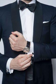 Midnight blue: Check. Shawl collar: Check.  ...Wristwatch and silver cummerbund?