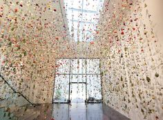 Amazing art work with hanging flowers made by Rebecca Louise Law. See more of her flower art pieces here.