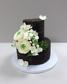 Round Chocolate ganache and white flowers wedding cake