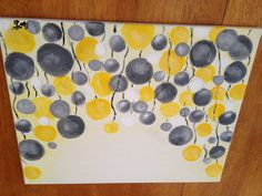 Painting in yellow and gray.I want to try and do this for my apartment.it would go with the couch