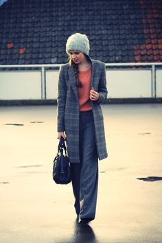Great coat and sweater.