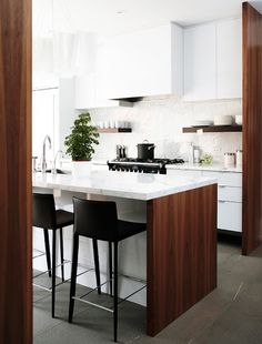 modern but warm and inviting kitchen. do not want a sterile modern environment. walnut and white lacquer modern kitchen /