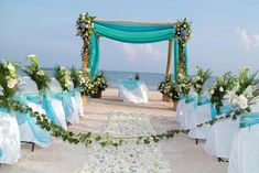 Beach Wedding - showing use of teal in the arch - would use more white in the arch and white uncovered chairs.