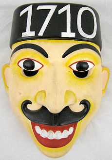Folk Mask-Policeman        Mask carving and its use in folk theater are ancient Sri Lankan tradition. This folk theater mask represents a policeman and is made of a soft and light balsa (kaduru) wood.