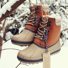Toasty warm details adorn these darling duck boots. Designed with a traditional lace-up front, rubber sole, and fully lined sherpa inner lining. The perfect pair of duck boots for chilly weather. - Co