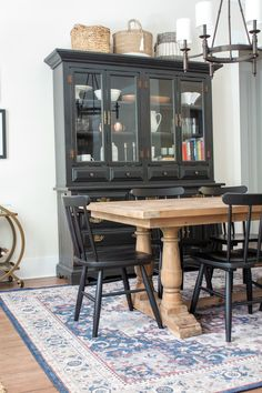 Check out this eclectic dining room which features black Scandinavian chairs, reclaimed dining hutch and a reclaimed wood dining table Black Dining Room Furniture, Dining Room Hutch, Black Dining Room Chairs, Dinning Room Tables, Dining Room Design, Kitchen Hutch, Black Dining Tables, Black Buffet Table, Eclectic Dining Chairs